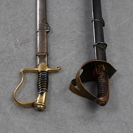 Two swedish 19th cenury military swords with scabbards.