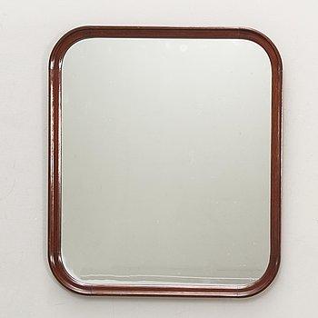 A Swedish mahogany mid 1900s mirror.