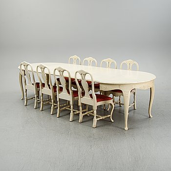 A rococo style dining set with a around table and eight chairs, 20th Century.