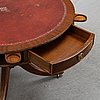 A mahogany carousel table, first half of the 20th century.