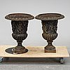 A pair of cast iron urns, second half of the 20th century.