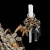 An oscarian gilt brass eight-light chandelier.