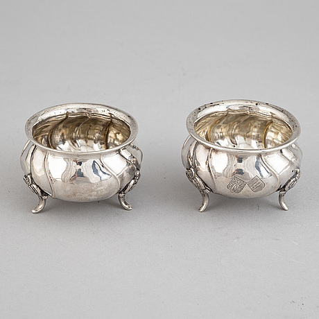 A set of eight rococo-style silver salt cellars, including cg hallberg 1920.