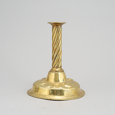 A 19th century baroque style candlestick, with older parts.