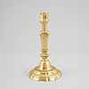 A late baroque brass candlestick, first half of the 18th century.