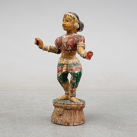 A carved and painted indian religious effigy, ca. 1900.