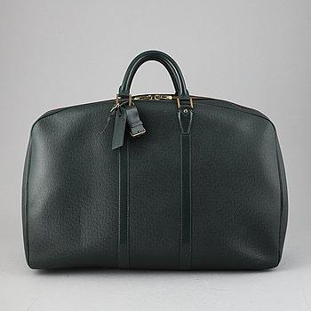 Louis Vuitton, a green Taiga 'Helanga' suitcase with garment bag, 1994.