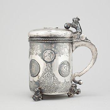 A parcel-gilt silver baroque style tankard.