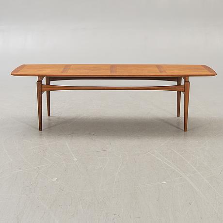 A 1960s teak coffee table, probably denmark.