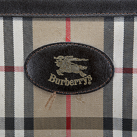 A burberry weekend bag and scarf.