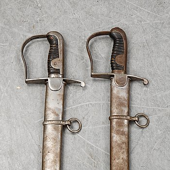 Two Swedish artillery swords model 1831 with scabbards.