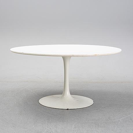 A 'tulip' table by eero saarinen, arkana, england.