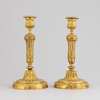 A pair of Louis XVI candlesticks.