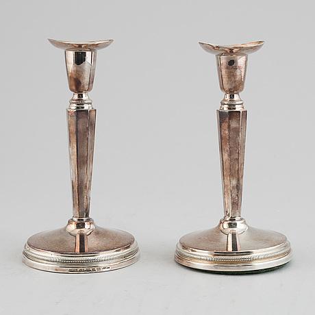 Eric löfman, a pair of silver candlesticks, silver, mema, lidköping 1999.