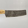 A swedish early 1900s chopping block with knife.