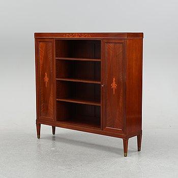 A 20th century mahogany veneered bookshelf.