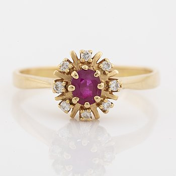 18K gold, ruby and brilliant cut diamond ring.
