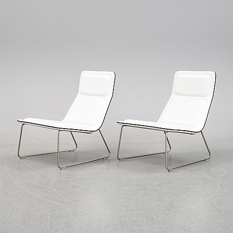 A pair of 'low pad chairs' by jasper morrison for cappelini, designed 1999.