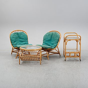 A rattan lounge set with two chairs, table and a trolley. Second half of the 20th Century.