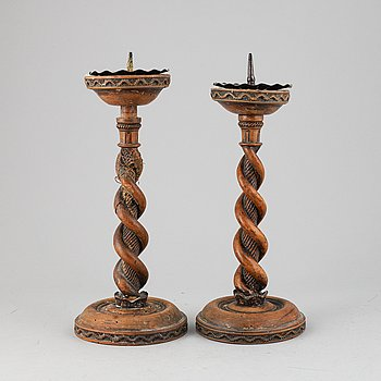 A pair of carved candle sticks, England 18th/19th Century.