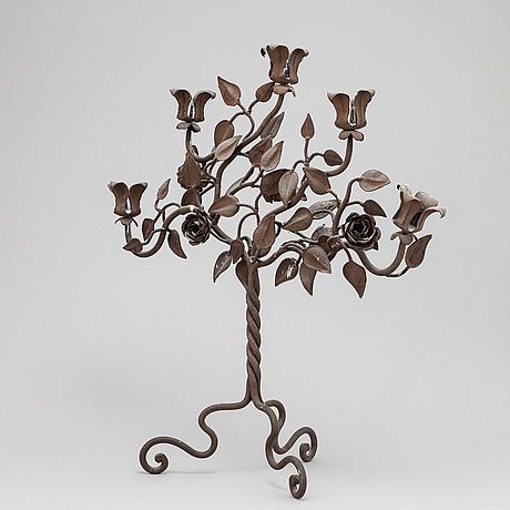 A wrought iron candelabra, presumably southern europe.