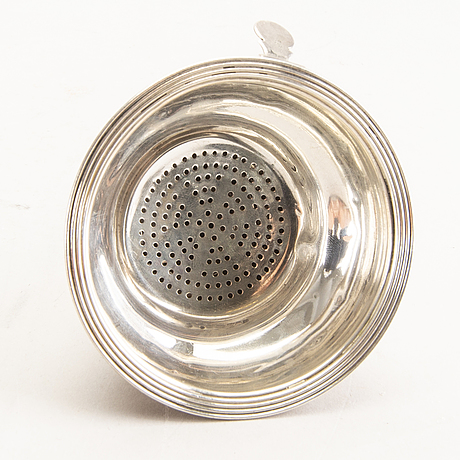 A 19th century english silver wine-strainer london 1813.