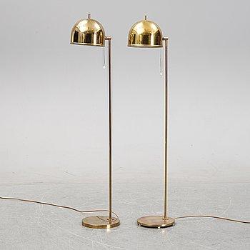 Eje Ahlgren, a pair of model G-075 brass floor lights, Bergboms, 1960's/1970's.