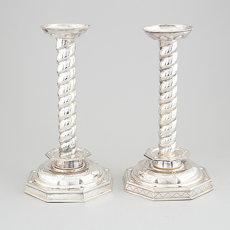 A pair of baroque style silver plated candle sticks, 20th century.