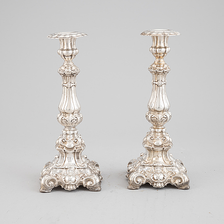 A pair of silver candlesticks, dated 1857.