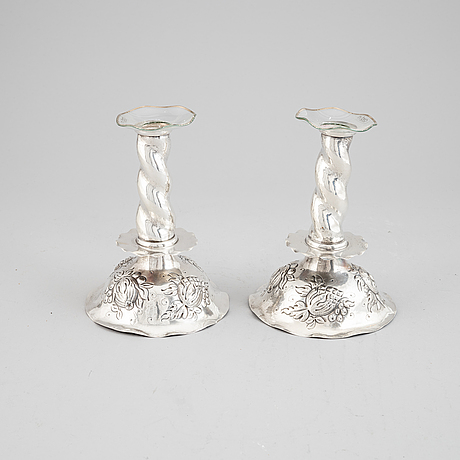 A pair of silver candle stick from gab, 1945.