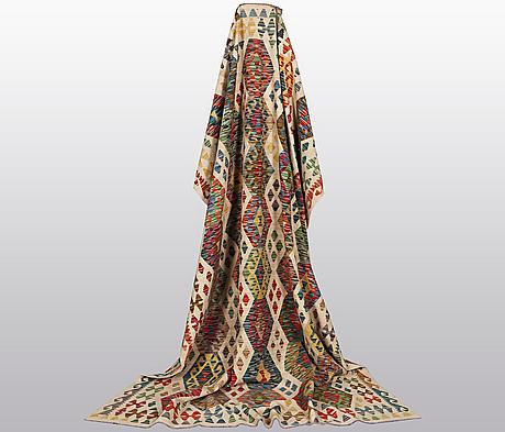 A carpet, kilim, ca 300 x 207 cm.