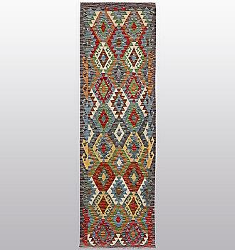 A carpet, kilim, ca 293 x 83 cm.