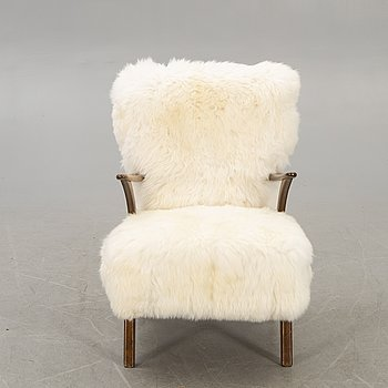 A 1950s armchair with sheepskin.
