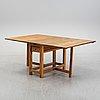 A 19th century gate-leg table.