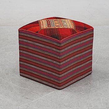A kilim footstool.