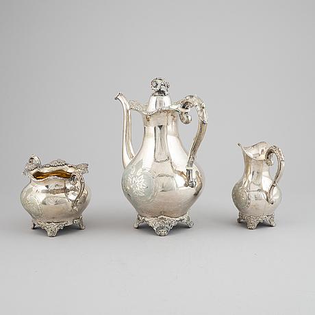 A three piece silver coffee service by carl hjulström, dated 1902.