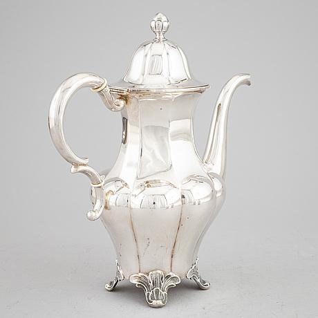 A swedish silver coffee pot, creamer and sugar bowl.