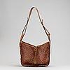 Loewe, a brown woven leather handbag.