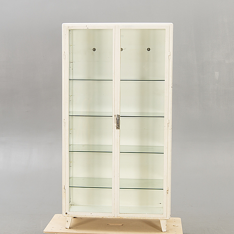 A mid 1900s european painted metal medicine cabinet.