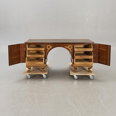 An empire style mahogany desk 20th century.