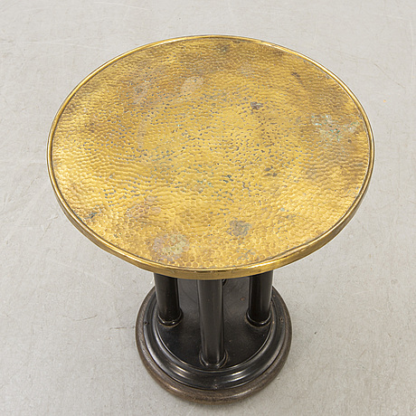 An early 1900s art deco side table.