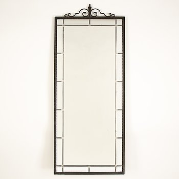 A 1920's mirror with an iron frame.