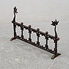 An art noveu iron fireplace stand by johan andersson ystad, early 20th century.