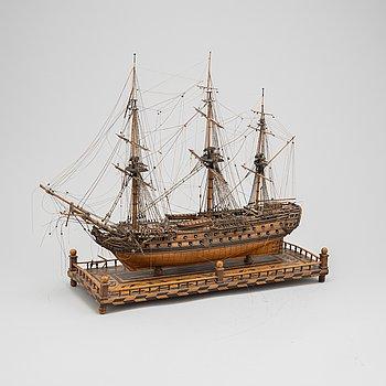 A 18th Century wooden ship model.