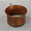 A 19th century copper pot.
