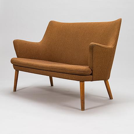 Hans j wegner, a 1950's sofa for  för ap-stolen denmark.