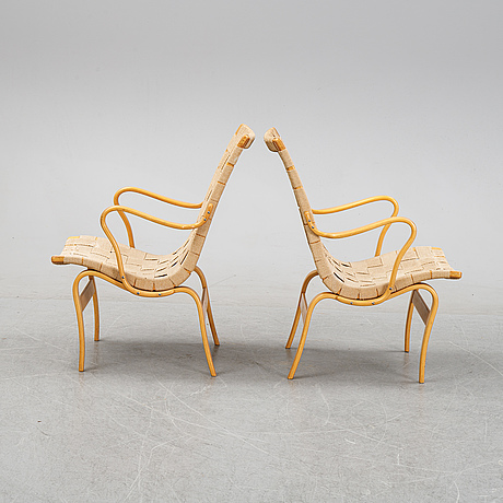 A pair of 'eva' lounge chairs by bruno mathsson for firma karl mathsson, dated 1962.