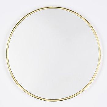 A brass circular mirror, second half of the 20th century.