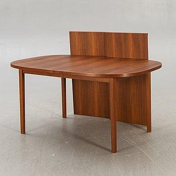 A 1960s/70s teak dining table.