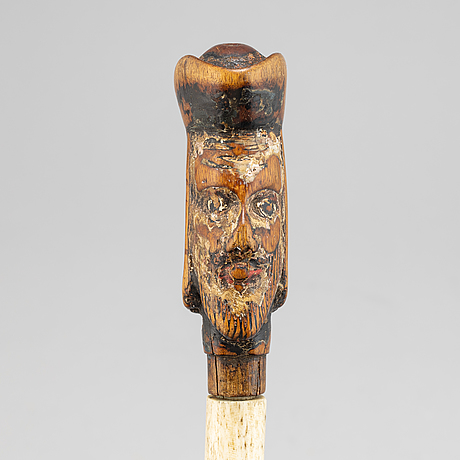 A wood and bone 19th century walking stick.